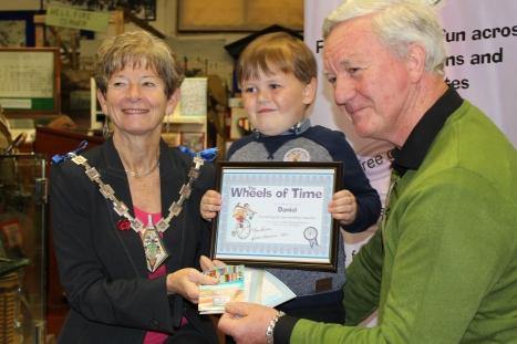 Daniel receiving his certificate and prize at Ashford Museum